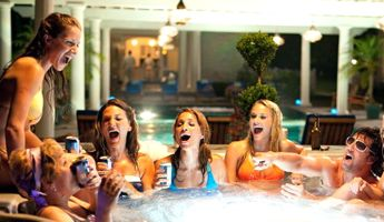 Adam Sandler and women in hot tub