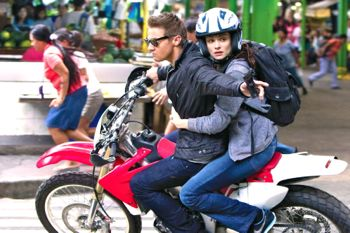 Bourne Legacy's Jeremy Renner and Rachel Weisz escape on motorbike