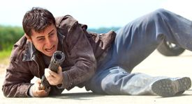 Looper's Joseph Gordon-Levitt fires on a Gat