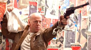 Looper has Bruce Willis travel back to past to confront younger self