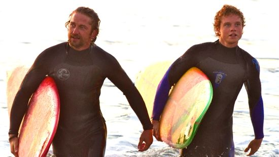 Gerard Butler and Jonny Weston come out of the surf