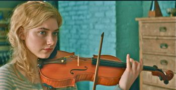 In A Late Quartet Imogen Poots practices the violin