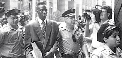 Central Park Five accused rapist Yusef Salaam is escorted by police
