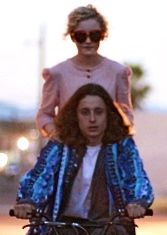 In Electrick Children Julia Garner rides bike with Rory Culkin