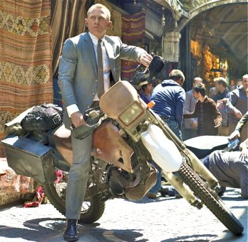 Skyfall star Daniel Craig as James Bond grabs a motorcycle to chase the villain