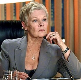 Skyfall's Judi Dench plays M, spymaster at her desk