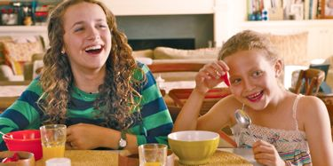 In This is 40 Judd Apatow's daughters laugh at breakfast