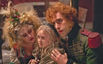 Helena Bonham Carter and Sacha Baron Cohen fiercely hold onto their young charge