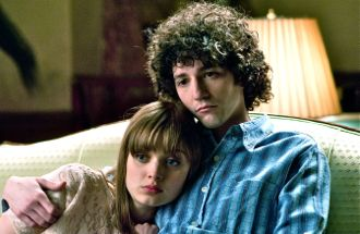 Note Fade Away's Bella Heathcote and John Magaro cuddle
