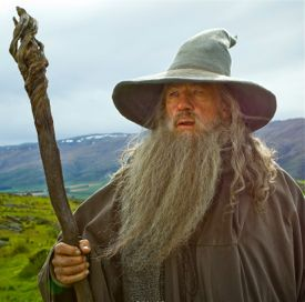 Ian McKellen as Wizard Gandalf looks for enemies in The Hobbit
