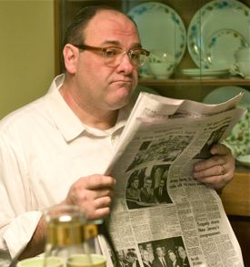 In Not Fade Away James Gandolfini reads the newspaper