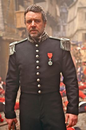 Russell Crowe's villain in Les Mis surveys a street after battle
