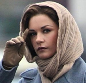Broken City's Catherine Zeta-Jones watches for a PI tailing her