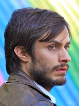 NO's Gael Garcia Bernal in front of rainbow advertising art