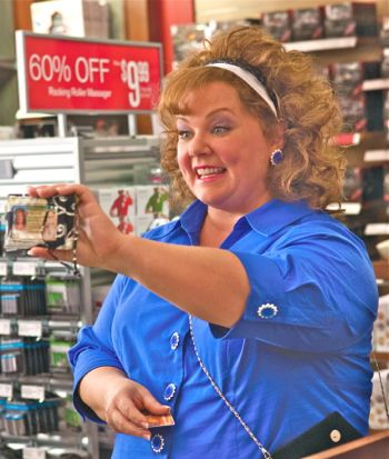 Identity Thief Melissa McCarthy shows false ID