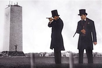 Lincoln aims rifle as bodyguard watches