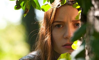Stokker's Mia Wasikowska peers through a bush
