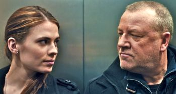 The Sweeney's Hayley Atwell glances at Ray Winstone in a lift
