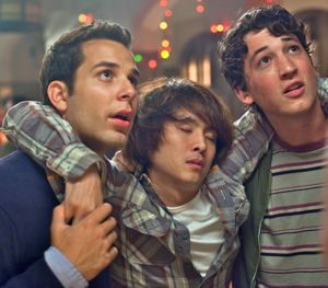 Skylar Astin and Myles Teller carry unconscious buddy Justin Chon
