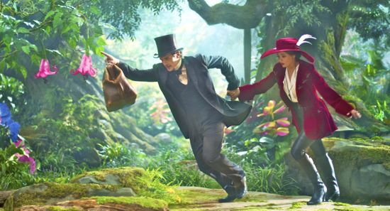 James Franco and Mila Kunis run from Oz creatures