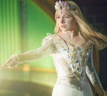 Michelle Williams points wand in Oz Great & Powerful