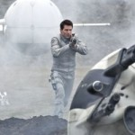 Tom Cruise in Oblivion fires at enemy