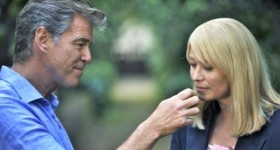 Pierce Brosnan shows Trine Dyrholm a flower