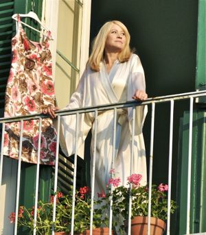 Trine Dyrholm gazes from balcony in Love Is All You Need