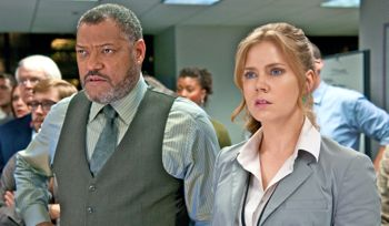 Man of Steel's Laurence Fishburne and Amy Adams watch TV with alarm
