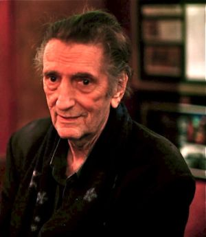 Harry Dean Stanton sits at Dan Tana's bar