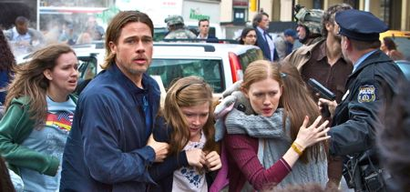 Brad Pitt escorts terrified family in urban chaos