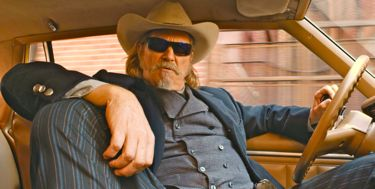 R.I.P.D.'s Jeff Bridges leans back inside his car
