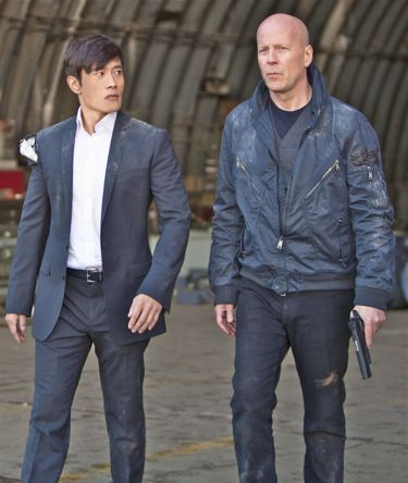 Byung Hun Lee and Bruce Willis walk out of hanger