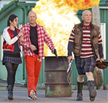 Red 2's Mary-Louise Parker, Bruce Willis and John Malkovich stroll away from trash can fire