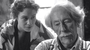 Artist and Model's Aida Folch leans over Jean Rochefort's shoulder