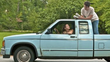 Shailene Woodley and Miles Teller deliver newspapers in a truck
