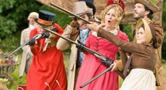 Austenland's cast aim rifles in all directions