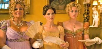 Austenland's Jennifer Coolidge, Keri Russell & Georgia King sit in period costumes on couch