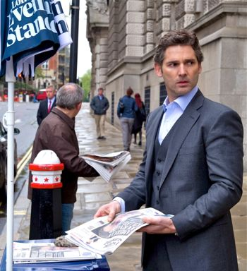 Closed Circuit's Eric Bana reads newspaper on London street