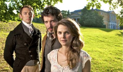 Austenland's Keri Russell with JJ Feild and Bret McKenzie pose in front of Regency mansion