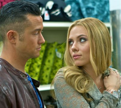 Don Jon's Scarlett Johansson looks over shoulder at Joseph Gordon-Levitt