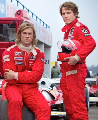 Rush's Chris Hemsworth and Daniel Bruhl pose near racetrack