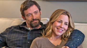 Prisoners' Hugh Jackman puts arm around Maria Bello