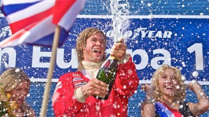 Rush's Chris Hemsworth pops champagne cork after a race