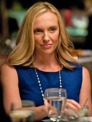 Enough Said's Toni Collette smiles at dinner table