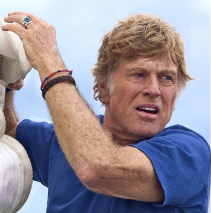All is Lost's Robert Redford clings to a mast as he stares at sea