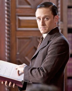 Kill Your Darlings' Ben Foster as William Burroughs looks up from book