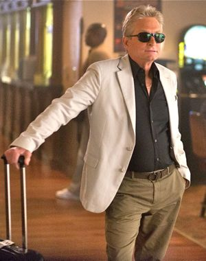 Last Vegas' Michael Douglas waits in hotel lobby with luggage