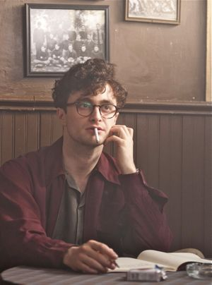 Kill Your Darlings' Daniel Radcliffe as Allen Ginsberg sits at coffee house table