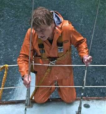 All is Lost's Robert Redford clings to side of sailboat
